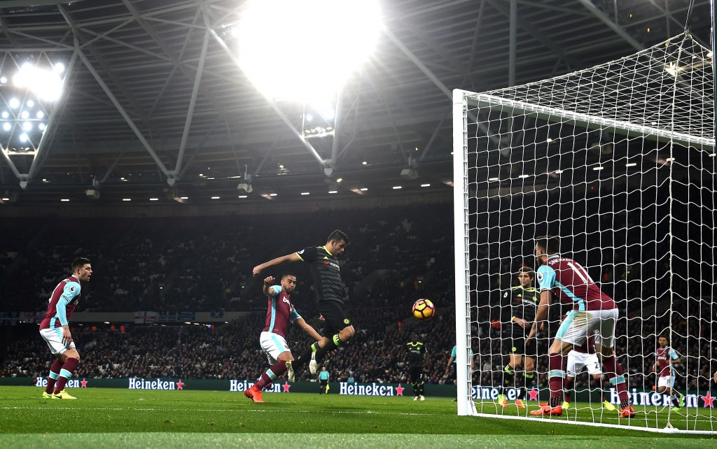 STRATFORD, ENGLAND - MARCH 06: Diego Costa of Chelsea scores his sides second goal during the Premier League match between West Ham United and Chelsea at London Stadium on March 6, 2017 in Stratford, England. (Photo by Michael Regan/Getty Images)