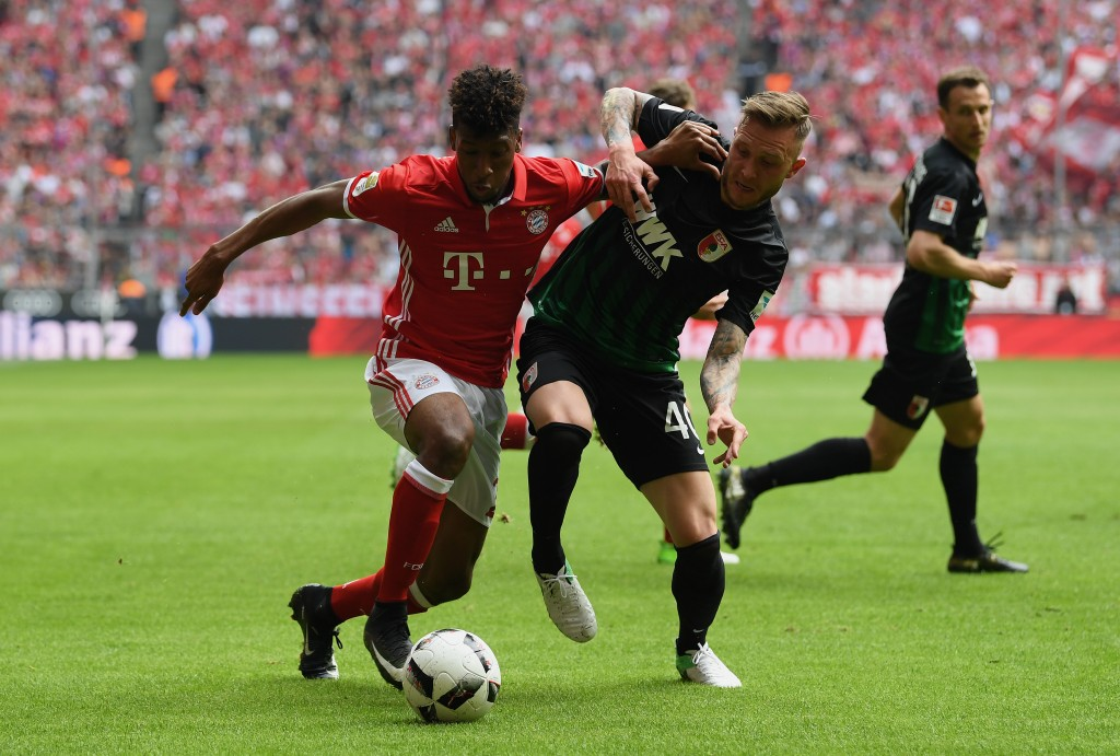 MUNICH, GERMANY - APRIL 01: Kingsley Coman of FC Bayern Muenchen is challenged by Tim Rieder of Augbsurg during the Bundesliga match between Bayern Muenchen and FC Augsburg at Allianz Arena on April 1, 2017 in Munich, Germany. (Photo by Matthias Hangst/Bongarts/Getty Images)