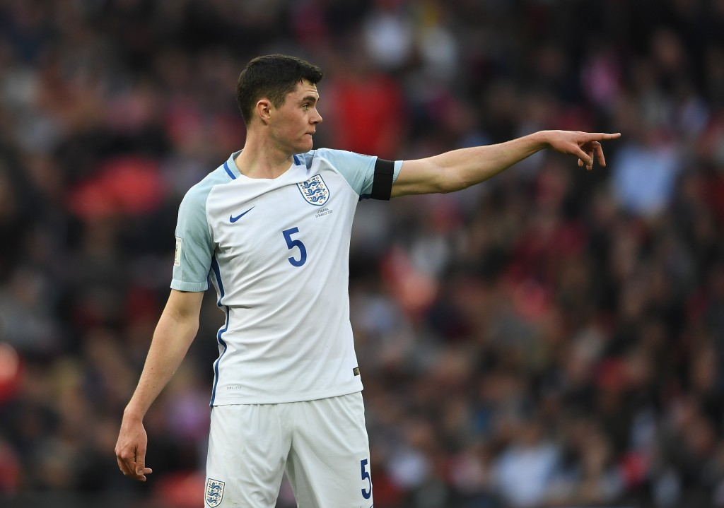 LONDON, ENGLAND - MARCH 26: Michael Keane of England gestures to his team mates during the FIFA 2018 World Cup Qualifier between England and Lithuania at Wembley Stadium on March 26, 2017 in London, England. (Photo by Laurence Griffiths/Getty Images)