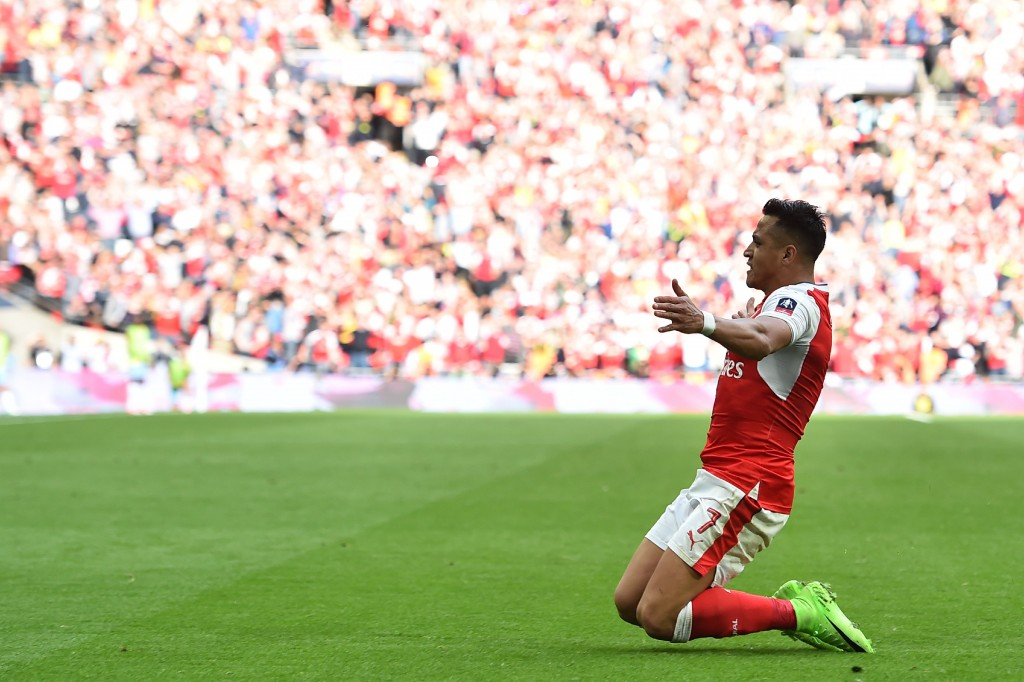 Arsenal's Chilean striker Alexis Sanchez celebrates scoring their second goal during the FA Cup semi-final football match between Arsenal and Manchester City at Wembley stadium in London on April 23, 2017. / AFP PHOTO / Glyn KIRK / NOT FOR MARKETING OR ADVERTISING USE / RESTRICTED TO EDITORIAL USE (Photo credit should read GLYN KIRK/AFP/Getty Images)