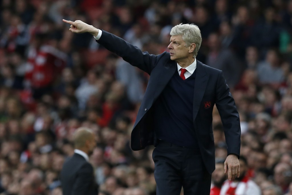 Arsenal's French manager Arsene Wenger gestures on the touchline during the English Premier League football match between Arsenal and Manchester City at The Emirates in London, on April 2, 2017. The game finished 2-2. / AFP PHOTO / IKIMAGES / Ian KINGTON / RESTRICTED TO EDITORIAL USE. No use with unauthorized audio, video, data, fixture lists, club/league logos or 'live' services. Online in-match use limited to 45 images, no video emulation. No use in betting, games or single club/league/player publications. (Photo credit should read IAN KINGTON/AFP/Getty Images)