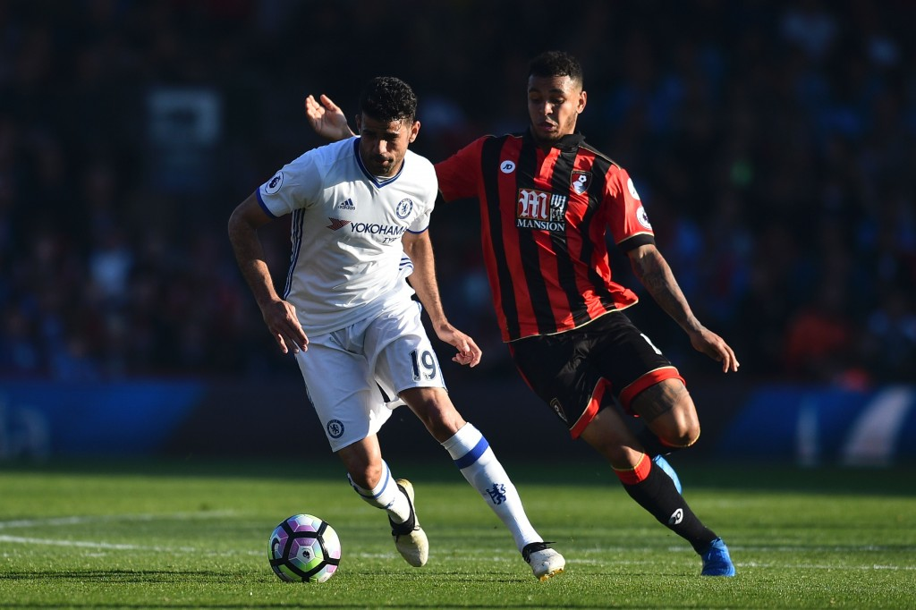 Bournemouth's Norwegian striker Joshua King (R) chases Chelsea's Brazilian-born Spanish striker Diego Costa (L) during the English Premier League football match between Bournemouth and Chelsea at the Vitality Stadium in Bournemouth, southern England on April 8, 2017. / AFP PHOTO / Glyn KIRK / RESTRICTED TO EDITORIAL USE. No use with unauthorized audio, video, data, fixture lists, club/league logos or 'live' services. Online in-match use limited to 75 images, no video emulation. No use in betting, games or single club/league/player publications. / (Photo credit should read GLYN KIRK/AFP/Getty Images)