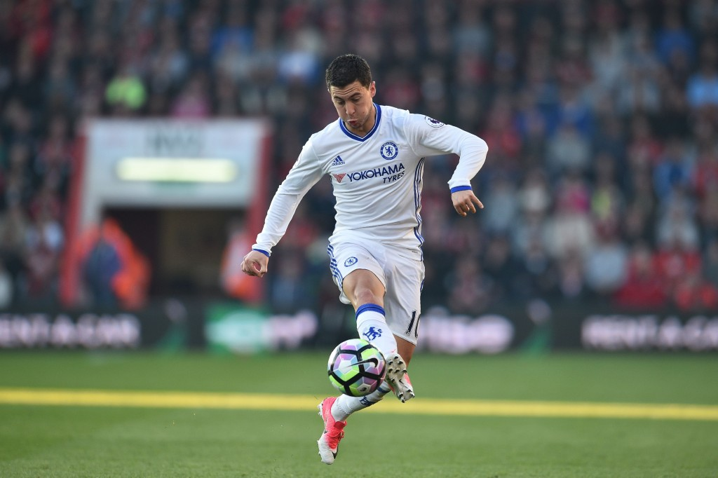 Chelsea's Belgian midfielder Eden Hazard chases the ball down during the English Premier League football match between Bournemouth and Chelsea at the Vitality Stadium in Bournemouth, southern England on April 8, 2017. / AFP PHOTO / Glyn KIRK / RESTRICTED TO EDITORIAL USE. No use with unauthorized audio, video, data, fixture lists, club/league logos or 'live' services. Online in-match use limited to 75 images, no video emulation. No use in betting, games or single club/league/player publications. / (Photo credit should read GLYN KIRK/AFP/Getty Images)