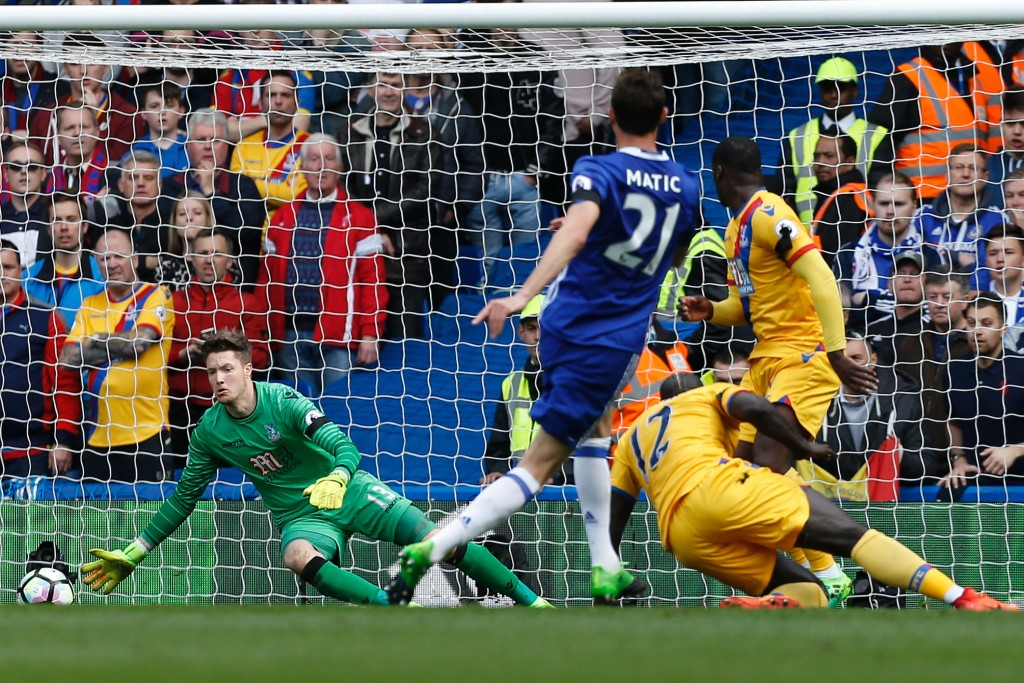 Crystal Palace's Welsh goalkeeper Wayne Hennessey (L) prpares to save from Chelsea's Serbian midfielder Nemanja Matic during the English Premier League football match between Chelsea and Crystal Palace at Stamford Bridge in London on April 1, 2017. / AFP PHOTO / Ian KINGTON / RESTRICTED TO EDITORIAL USE. No use with unauthorized audio, video, data, fixture lists, club/league logos or 'live' services. Online in-match use limited to 75 images, no video emulation. No use in betting, games or single club/league/player publications. / (Photo credit should read IAN KINGTON/AFP/Getty Images)