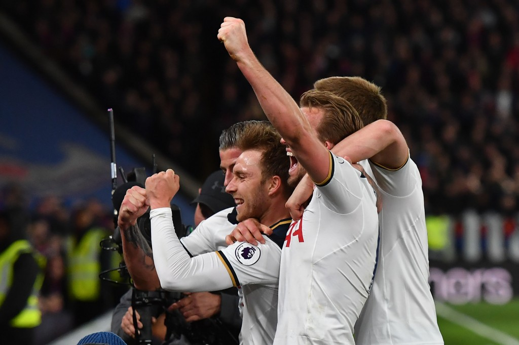 Tottenham Hotspur's Danish midfielder Christian Eriksen (L) celebrates scoring the opening goal with teammates during the English Premier League football match between Crystal Palace and Tottenham Hotspur at Selhurst Park in south London on April 26, 2017. / AFP PHOTO / Ben STANSALL / RESTRICTED TO EDITORIAL USE. No use with unauthorized audio, video, data, fixture lists, club/league logos or 'live' services. Online in-match use limited to 75 images, no video emulation. No use in betting, games or single club/league/player publications. / (Photo credit should read BEN STANSALL/AFP/Getty Images)