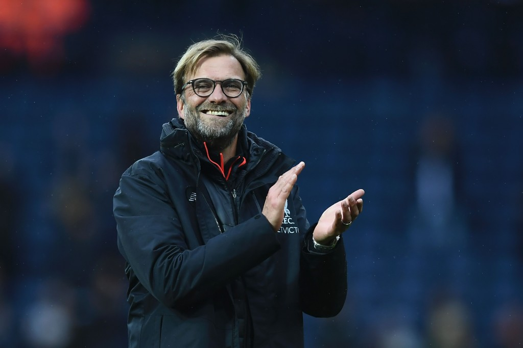 Liverpool's German manager Jurgen Klopp celebrates winning the English Premier League football match between West Bromwich Albion and Liverpool at The Hawthorns stadium in West Bromwich, central England, on April 16, 2017. / AFP PHOTO / Justin TALLIS / RESTRICTED TO EDITORIAL USE. No use with unauthorized audio, video, data, fixture lists, club/league logos or 'live' services. Online in-match use limited to 75 images, no video emulation. No use in betting, games or single club/league/player publications. / Bringing in the new era.(Photo credit should read JUSTIN TALLIS/AFP/Getty Images)