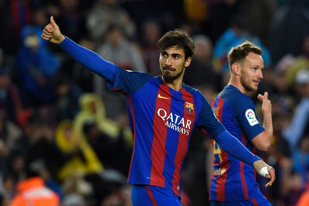 Barcelona's Portuguese midfielder Andre Gomes (L) celebrates after scoring a goal during the Spanish league football match FC Barcelona vs CA Osasuna at the Camp Nou stadium in Barcelona on April 26, 2017. / AFP PHOTO / LLUIS GENE (Photo credit should read LLUIS GENE/AFP/Getty Images)