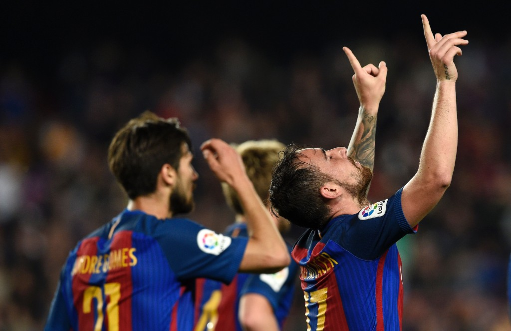 Barcelona's forward Paco Alcacer (R) celebrates a goal during the Spanish league football match FC Barcelona vs Real Sociedad at the Camp Nou stadium in Barcelona on April 15, 2017. / AFP PHOTO / LLUIS GENE (Photo credit should read LLUIS GENE/AFP/Getty Images)