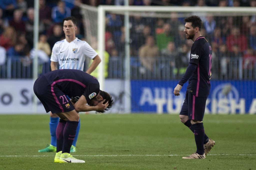 Barcelona's Portuguese midfielder Andre Gomes (L) and Barcelona's Argentinian forward Lionel Messi stand on the field during the Spanish league football match Malaga CF vs FC Barcelona at La Rosaleda stadium in Malaga on April 8, 2017. / AFP PHOTO / JORGE GUERRERO (Photo credit should read JORGE GUERRERO/AFP/Getty Images)