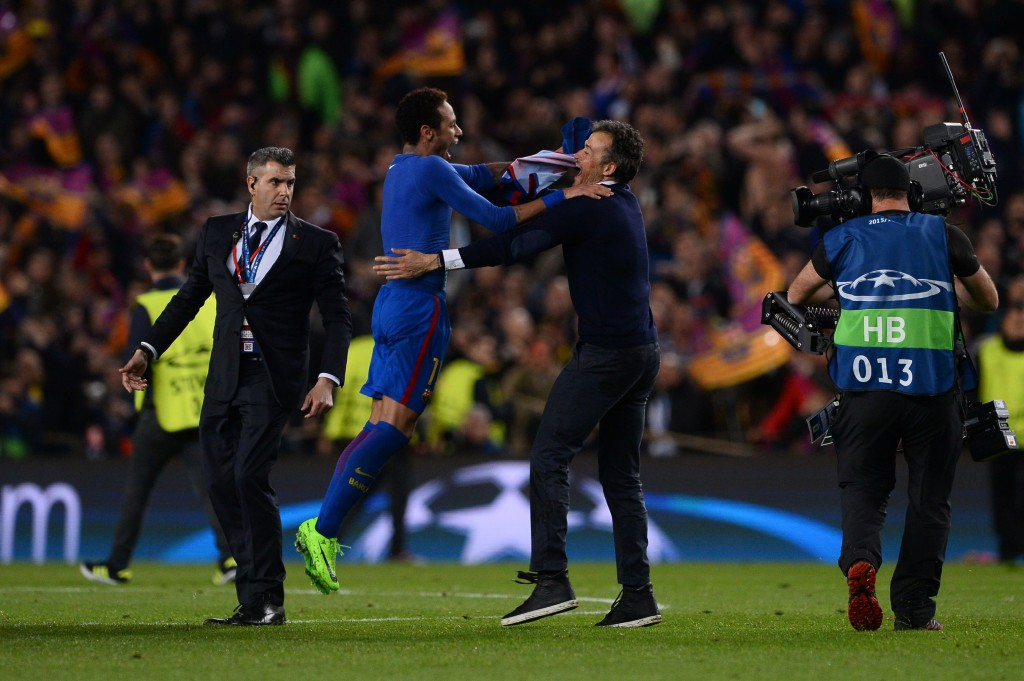 Barcelona's coach Luis Enrique (2ndR) celebrates with Barcelona's Brazilian forward Neymar their 6-1 victory at the end of the UEFA Champions League round of 16 second leg football match FC Barcelona vs Paris Saint-Germain FC at the Camp Nou stadium in Barcelona on March 8, 2017. / AFP PHOTO / Josep Lago (Photo credit should read JOSEP LAGO/AFP/Getty Images)