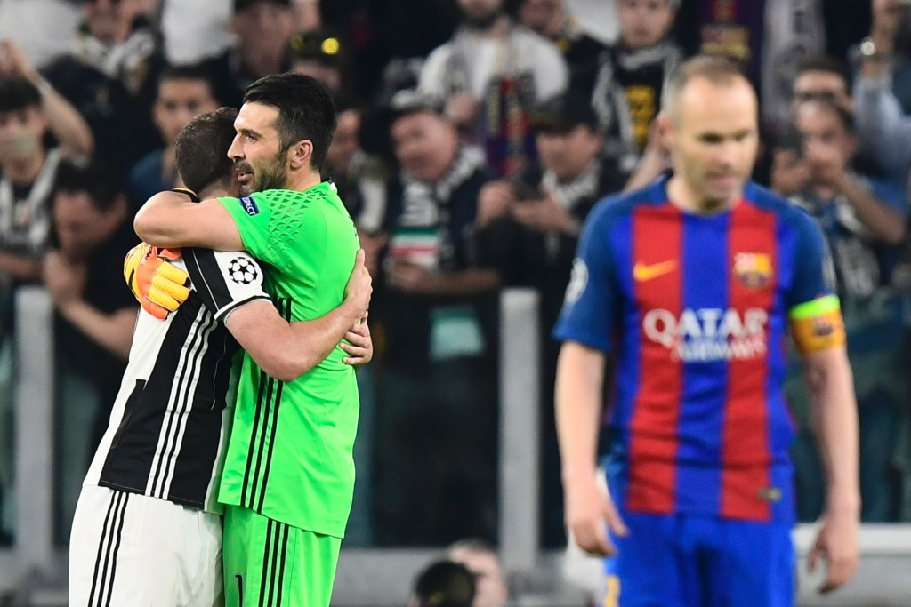 Juventus' goalkeeper from Italy Gianluigi Buffon and Juventus' forward from Argentina Gonzalo Higuain (L) celebrate after winning the UEFA Champions League quarter final first leg football match Juventus vs Barcelona, on April 11, 2017 at the Juventus stadium in Turin. Juventus won 3-0. / AFP PHOTO / MIGUEL MEDINA (Photo credit should read MIGUEL MEDINA/AFP/Getty Images)