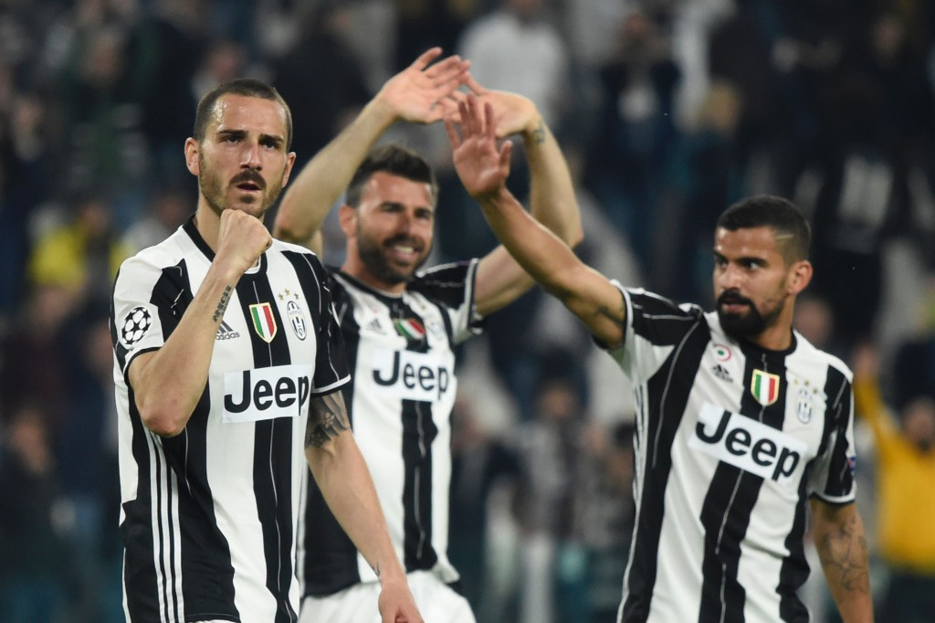Juventus' defender from Italy Leonardo Bonucci (L), Juventus' defender from Italy Andrea Barzagli and Juventus midfielder from Venezuela Tomas Rincon celebrate after winning the UEFA Champions League quarter final first leg football match Juventus vs Barcelona, on April 11, 2017 at the Juventus stadium in Turin. Juventus won 3-0. / AFP PHOTO / Miguel MEDINA (Photo credit should read MIGUEL MEDINA/AFP/Getty Images)