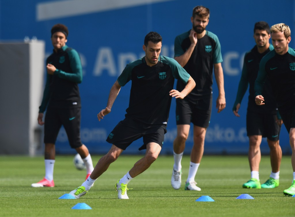 BARCELONA, SPAIN - APRIL 18: Sergio Busquets of Barcelona takes part in a drill with team mates during a FC Barcelona training session on the eve of their UEFA Champions League quarter final second leg match against Juventus at FC Barcelona Sports Centre on April 18, 2017 in Barcelona, Spain. (Photo by David Ramos/Getty Images)