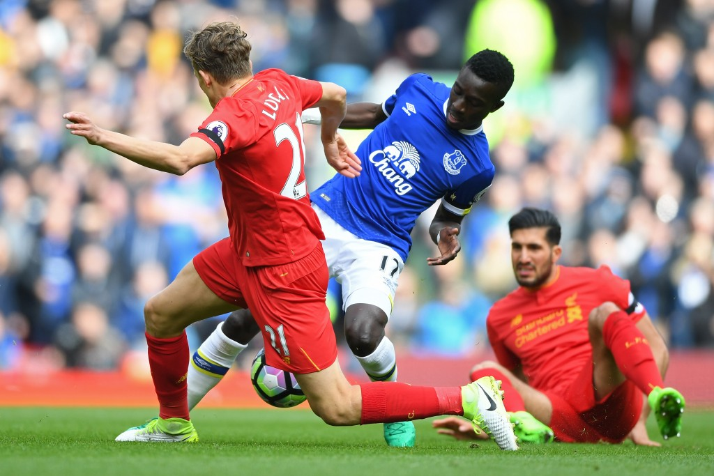 LIVERPOOL, ENGLAND - APRIL 01: Lucas Leiva of Liverpool (L) and Idrissa Gueye of Everton (R) battle for possession during the Premier League match between Liverpool and Everton at Anfield on April 1, 2017 in Liverpool, England. (Photo by Gareth Copley/Getty Images)