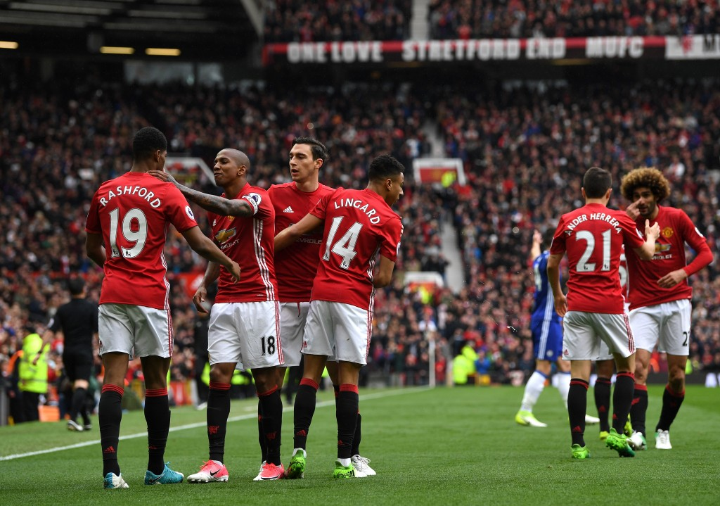 MANCHESTER, ENGLAND - APRIL 16: Marcus Rashford of Manchester United celebrates scoring his sides first goal with his Manchester United team mates during the Premier League match between Manchester United and Chelsea at Old Trafford on April 16, 2017 in Manchester, England. (Photo by Shaun Botterill/Getty Images)
