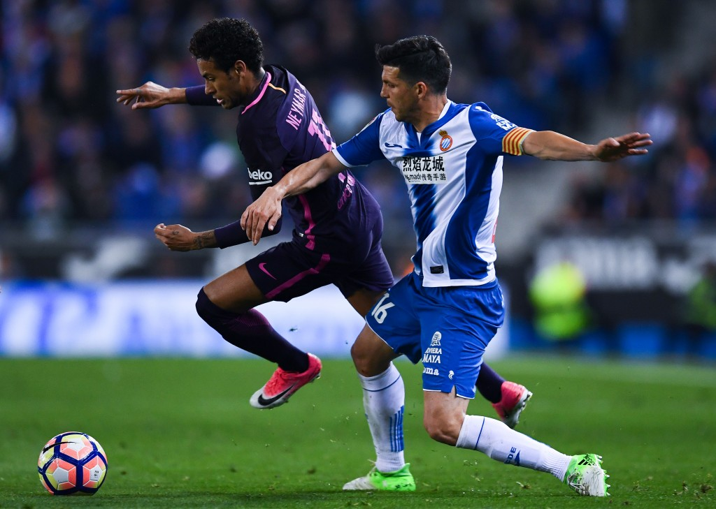 BARCELONA, SPAIN - APRIL 29: Neymar Jr. of FC Barcelona competes for the ball with Javi Lopez of RCD Espanyol during the La Liga match between RCD Espanyol and FC Barcelona at the RCDE Stadium on April 29, 2017 in Barcelona, Spaain. (Photo by David Ramos/Getty Images)
