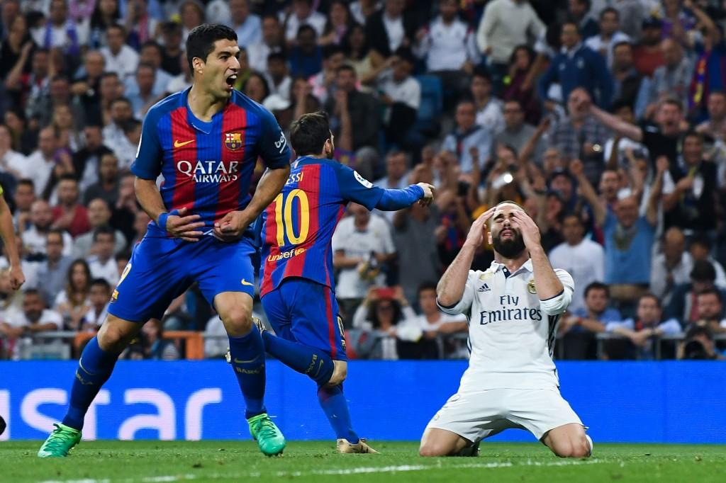 MADRID, SPAIN - APRIL 23: Daniel Carvajal of Real Madrid CF reacts as Lionel Messi of FC Barcelona (10) celebrates after scoring his team's third goal during the La Liga match between Real Madrid CF and FC Barcelona at the Santiago Bernabeu stadium on April 23, 2017 in Madrid, Spain. (Photo by David Ramos/Getty Images)