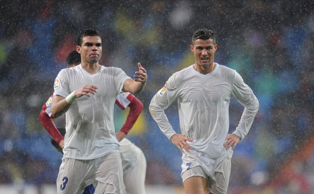 MADRID, SPAIN - NOVEMBER 26: Cristiano Ronaldo of Real Madrid reacts with Pepe during the La Liga match between Real Madrid CF and Real Sporting de Gijon at Estadio Santiago Bernabeu on November 26, 2016 in Madrid, Spain. (Photo by Denis Doyle/Getty Images)