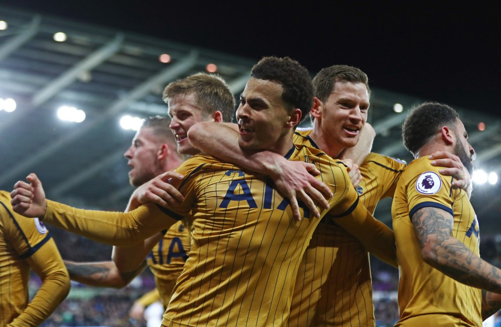 SWANSEA, WALES - APRIL 05: Dele Alli of Tottenham Hotspur celebrates scoring his sides first goal with his Tottenham Hotspur team mates during the Premier League match between Swansea City and Tottenham Hotspur at the Liberty Stadium on April 5, 2017 in Swansea, Wales. (Photo by Michael Steele/Getty Images)