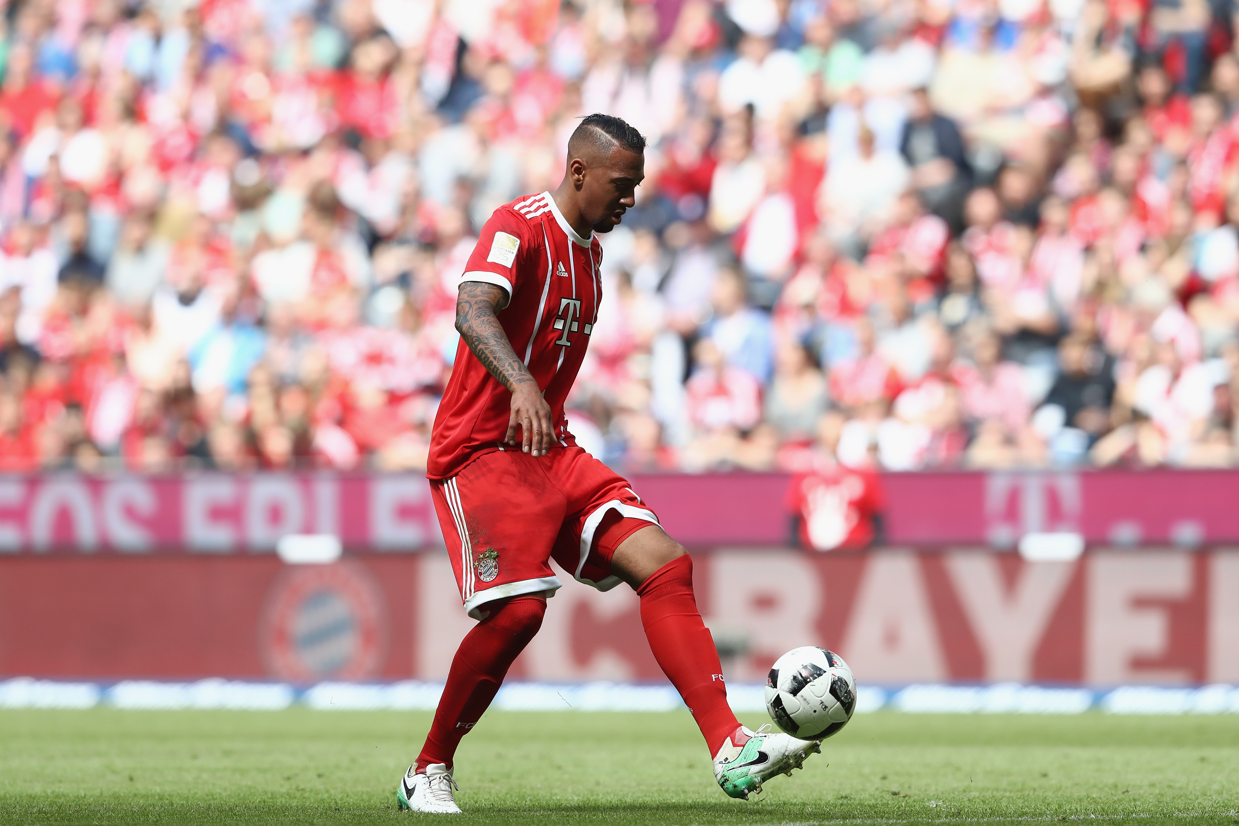 MUNICH, GERMANY - MAY 20: Jerome Boateng of Bayern Muenchen runs with the ball during the Bundesliga match between Bayern Muenchen and SC Freiburg at Allianz Arena on May 20, 2017 in Munich, Germany. (Photo by Alexander Hassenstein/Bongarts/Getty Images)