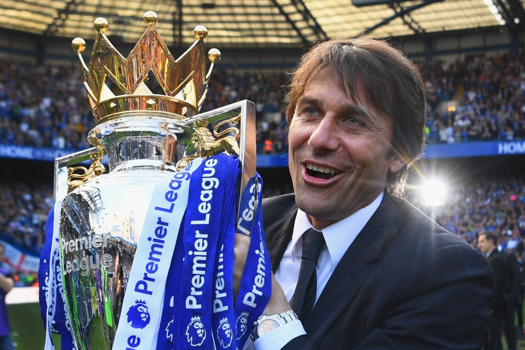 LONDON, ENGLAND - MAY 21: Antonio Conte, Manager of Chelsea poses with the Premier League Trophy after the Premier League match between Chelsea and Sunderland at Stamford Bridge on May 21, 2017 in London, England. (Photo by Michael Regan/Getty Images)