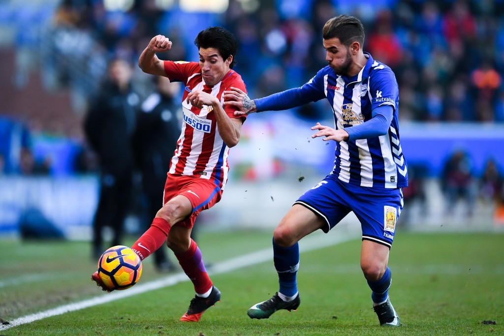 VITORIA-GASTEIZ, SPAIN - JANUARY 28: Nicolas Gaitan of Club Atletico de Madrid competes for the ball with Theo Hernandez of Deportivo Alaves during the La Liga match between Deportivo Alaves and Club Atletico de Madrid at Mendizorroza stadium on January 28, 2017 in Vitoria-Gasteiz, Spain. (Photo by David Ramos/Getty Images)