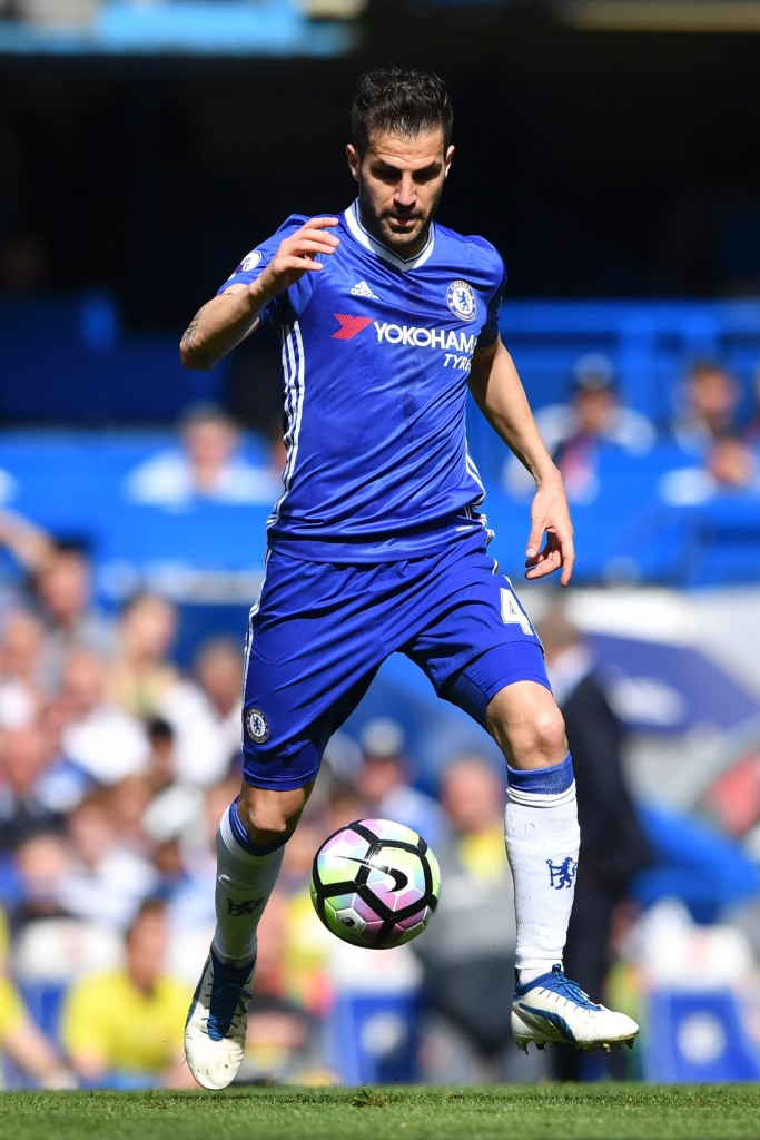Chelsea's Spanish midfielder Cesc Fabregas controls the ball during the English Premier League football match between Chelsea and Sunderland at Stamford Bridge in London on May 21, 2017. / AFP PHOTO / Ben STANSALL / RESTRICTED TO EDITORIAL USE. No use with unauthorized audio, video, data, fixture lists, club/league logos or 'live' services. Online in-match use limited to 75 images, no video emulation. No use in betting, games or single club/league/player publications. / (Photo credit should read BEN STANSALL/AFP/Getty Images)