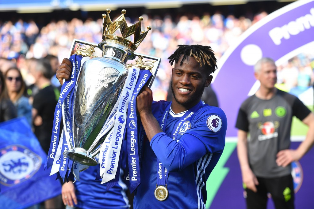 Chelsea's Belgian striker Michy Batshuayi poses with the English Premier League trophy, as players celebrate their league title win at the end of the Premier League football match between Chelsea and Sunderland at Stamford Bridge in London on May 21, 2017. Chelsea's extended victory parade reached a climax with the trophy presentation on May 21, 2017 after being crowned Premier League champions with two games to go. / AFP PHOTO / Ben STANSALL / RESTRICTED TO EDITORIAL USE. No use with unauthorized audio, video, data, fixture lists, club/league logos or 'live' services. Online in-match use limited to 75 images, no video emulation. No use in betting, games or single club/league/player publications. / (Photo credit should read BEN STANSALL/AFP/Getty Images)