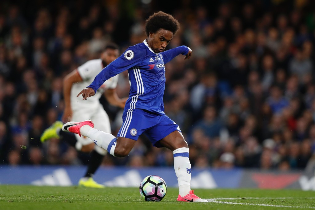 Chelsea's Brazilian midfielder Willian takes a shot but misses during the English Premier League football match between Chelsea and Watford at Stamford Bridge in London on May 15, 2017. / AFP PHOTO / Adrian DENNIS / RESTRICTED TO EDITORIAL USE. No use with unauthorized audio, video, data, fixture lists, club/league logos or 'live' services. Online in-match use limited to 75 images, no video emulation. No use in betting, games or single club/league/player publications. / (Photo credit should read ADRIAN DENNIS/AFP/Getty Images)