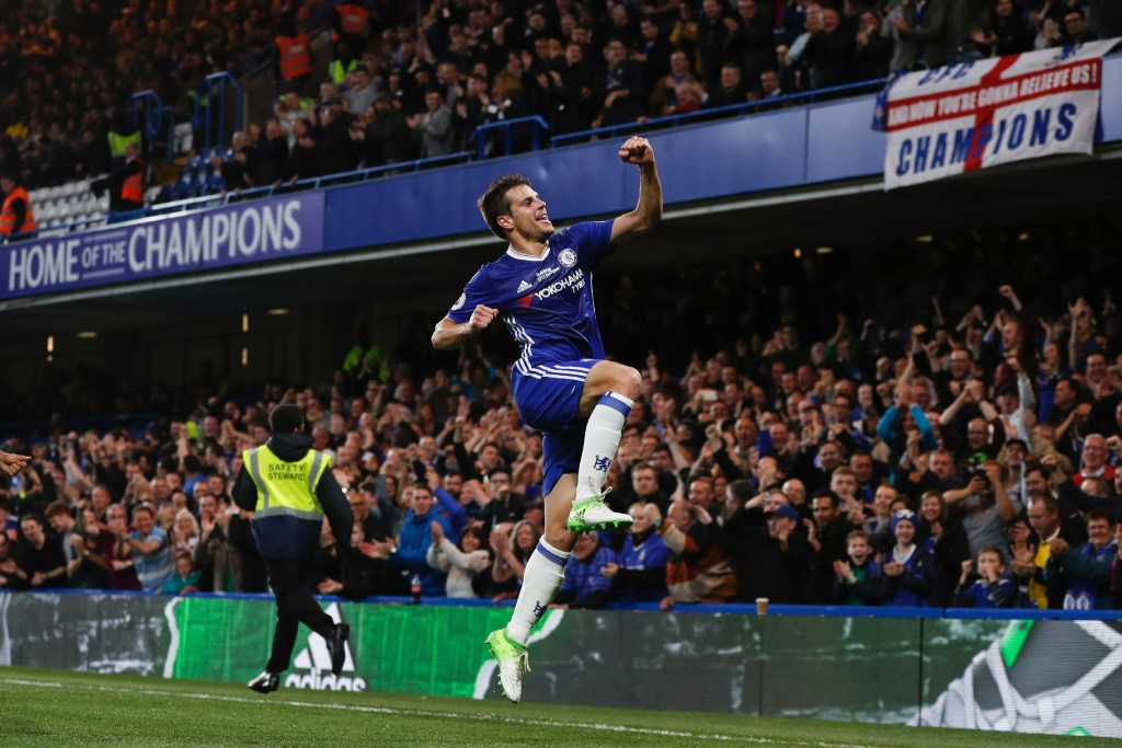 Chelsea's Spanish defender Cesar Azpilicueta celebrates scoring their second goal during the English Premier League football match between Chelsea and Watford at Stamford Bridge in London on May 15, 2017. / AFP PHOTO / Adrian DENNIS / RESTRICTED TO EDITORIAL USE. No use with unauthorized audio, video, data, fixture lists, club/league logos or 'live' services. Online in-match use limited to 75 images, no video emulation. No use in betting, games or single club/league/player publications. / (Photo credit should read ADRIAN DENNIS/AFP/Getty Images)