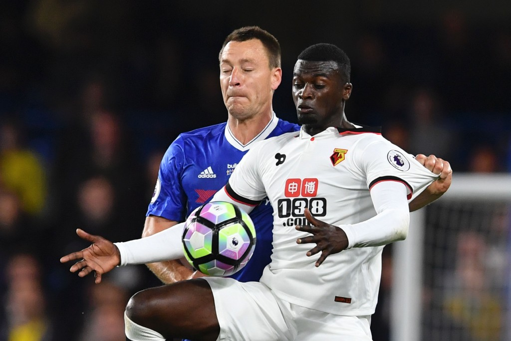Watford's French striker M'Baye Niang (R) tries to hold off Chelsea's English defender John Terry (L) during the English Premier League football match between Chelsea and Watford at Stamford Bridge in London on May 15, 2017. / AFP PHOTO / Ben STANSALL / RESTRICTED TO EDITORIAL USE. No use with unauthorized audio, video, data, fixture lists, club/league logos or 'live' services. Online in-match use limited to 75 images, no video emulation. No use in betting, games or single club/league/player publications. / (Photo credit should read BEN STANSALL/AFP/Getty Images)