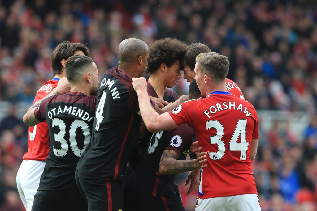 Manchester City's German midfielder Leroy Sane (3R) and Middlesbrough's Dutch midfielder Marten de Roon (2R) confront each other during the English Premier League football match between Middlesbrough and Manchester City at Riverside Stadium in Middlesbrough, northeast England on April 30, 2017. / AFP PHOTO / Lindsey PARNABY / RESTRICTED TO EDITORIAL USE. No use with unauthorized audio, video, data, fixture lists, club/league logos or 'live' services. Online in-match use limited to 75 images, no video emulation. No use in betting, games or single club/league/player publications. / (Photo credit should read LINDSEY PARNABY/AFP/Getty Images)