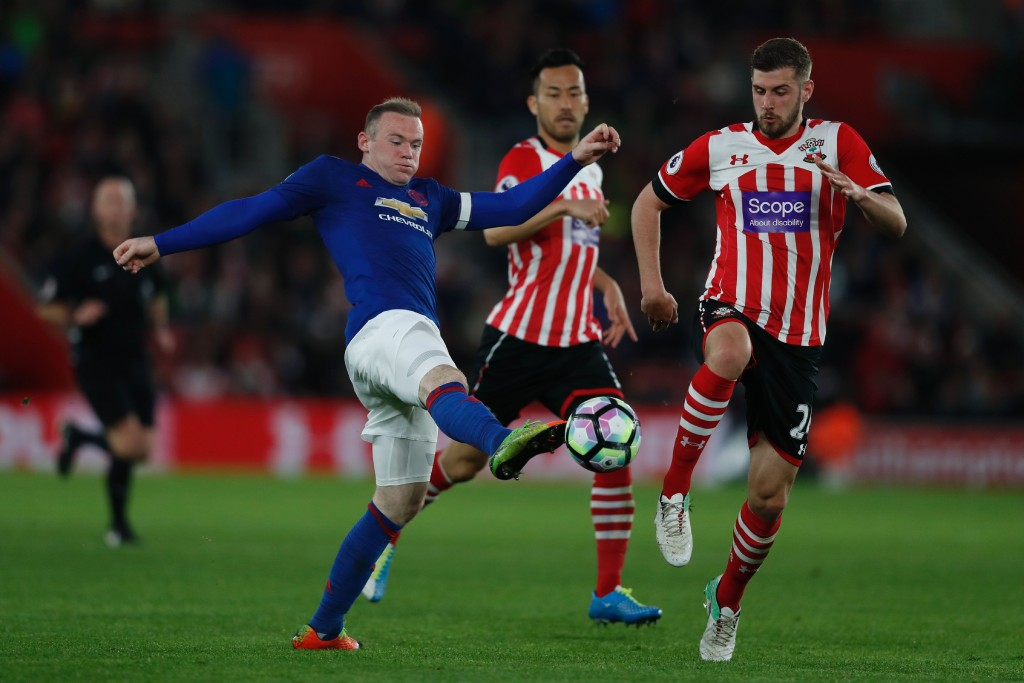 Manchester United's English striker Wayne Rooney (L) battles for the ball with Southampton's English defender Jack Stephens (R) during the English Premier League football match between Southampton and Manchester United at St Mary's Stadium in Southampton, southern England on May 17, 2017. / AFP PHOTO / Adrian DENNIS / RESTRICTED TO EDITORIAL USE. No use with unauthorized audio, video, data, fixture lists, club/league logos or 'live' services. Online in-match use limited to 75 images, no video emulation. No use in betting, games or single club/league/player publications. / (Photo credit should read ADRIAN DENNIS/AFP/Getty Images)