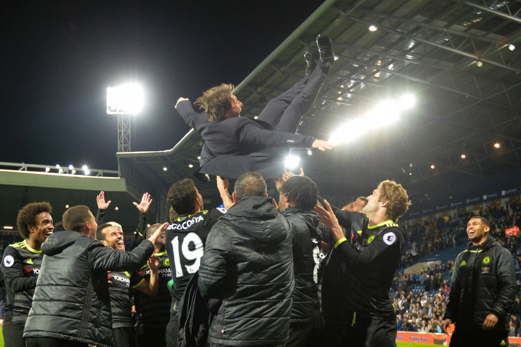 Chelsea's Italian head coach Antonio Conte (top) is thrown in the air by his players as they celebrate being confirmed Premier League champions after the English Premier League match between West Bromwich Albion and Chelsea at The Hawthorns stadium in West Bromwich, west Midlands on May 12, 2017. / AFP PHOTO / Anthony Devlin (Photo credit should read ANTHONY DEVLIN/AFP/Getty Images)
