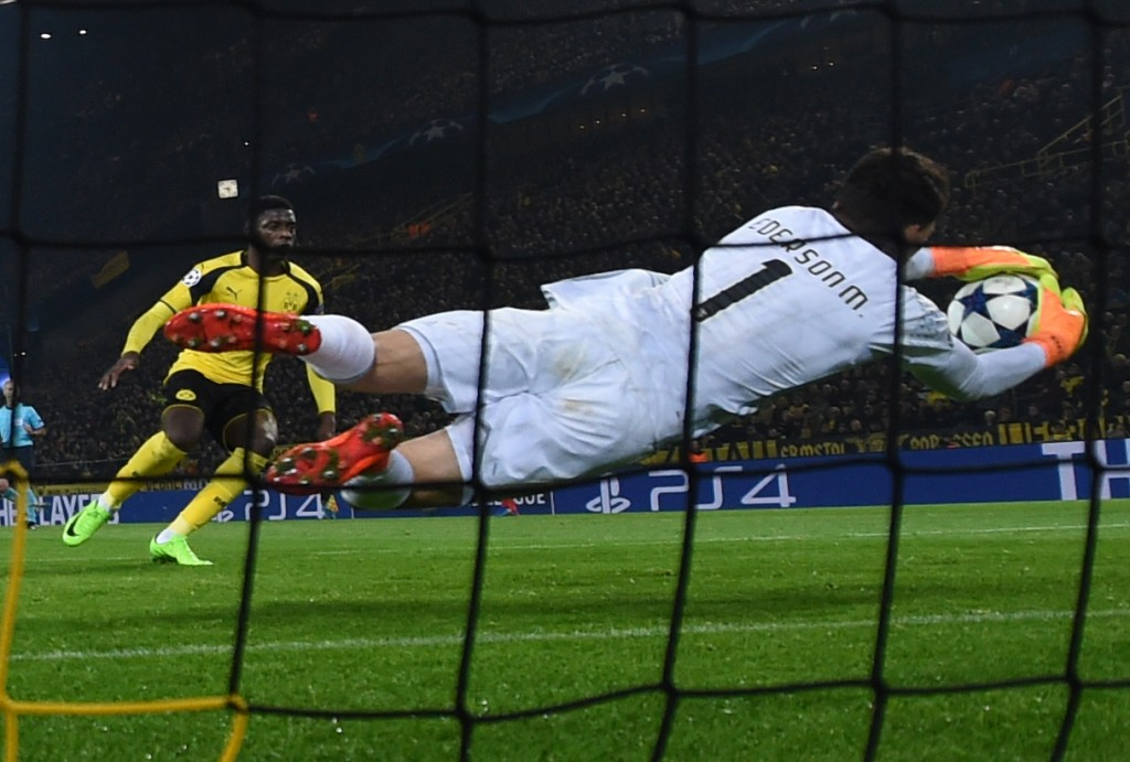 Benfica's Brazilian goalkeeper Ederson Moraes makes a save during the UEFA Champions League Round of 16, 2nd-leg football match Borussia Dortmund v SL Benfica in Dortmund, western Germany on March 8, 2017. / AFP PHOTO / PATRIK STOLLARZ (Photo credit should read PATRIK STOLLARZ/AFP/Getty Images)