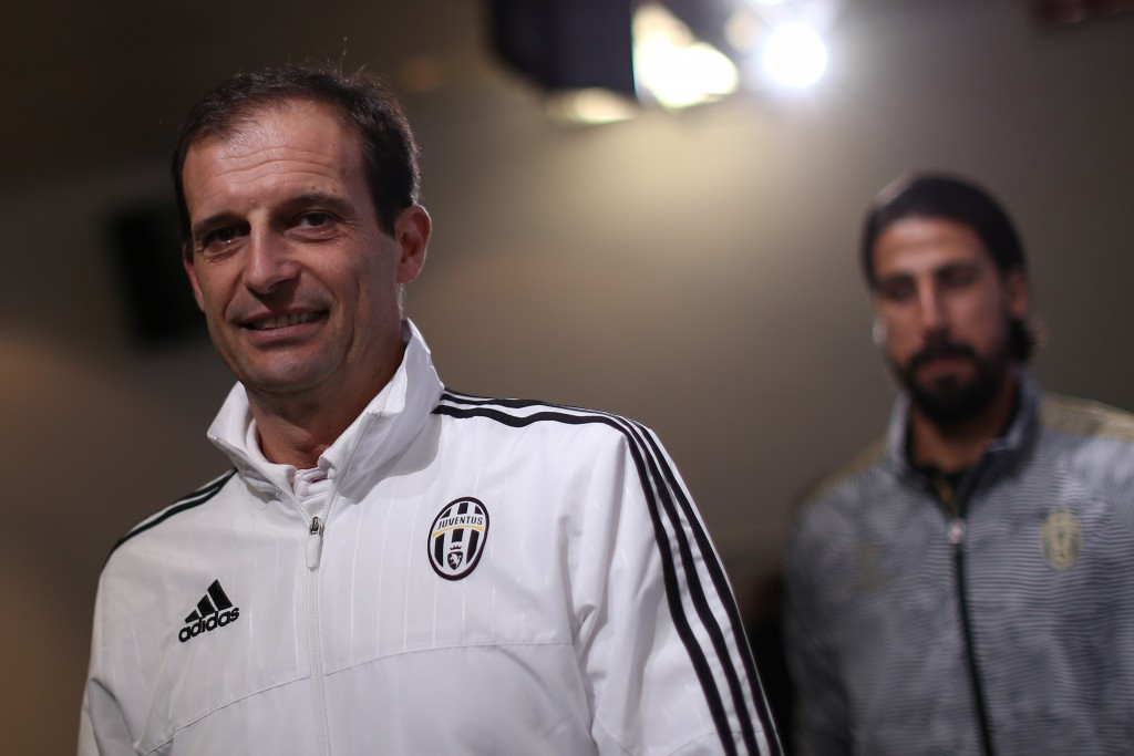 Juventus' coach Massimiliano Allegri (L) and Juventus' midfielder Sami Khedira from Germany give a press conference on the eve of the UEFA Champions League football match Juventus Vs Borussia Moenchengladbach on October 20, 2015 at the 'Juventus Stadium', in Turin. AFP PHOTO / MARCO BERTORELLO (Photo credit should read MARCO BERTORELLO/AFP/Getty Images)