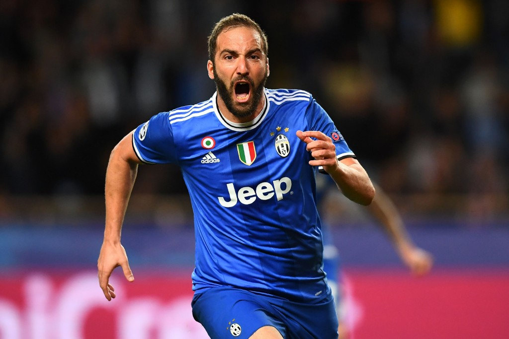 Juventus' forward from Argentina Gonzalo Higuain reacts after scoring a goal during the UEFA Champions League semi-final first leg football match Monaco vs Juventus at the Stade Louis II stadium in Monaco on May 3, 2017. / AFP PHOTO / FRANCK FIFE (Photo credit should read FRANCK FIFE/AFP/Getty Images)