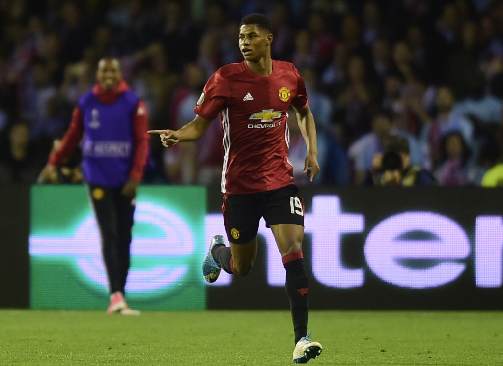 Manchester United's forward Marcus Rashford celebrates after scoring the opener during their UEFA Europa League semi final first leg football match RC Celta de Vigo vs Manchester United FC at the Balaidos stadium in Vigo on May 4, 2017. Manchester won 1-0. / AFP PHOTO / MIGUEL RIOPA (Photo credit should read MIGUEL RIOPA/AFP/Getty Images)