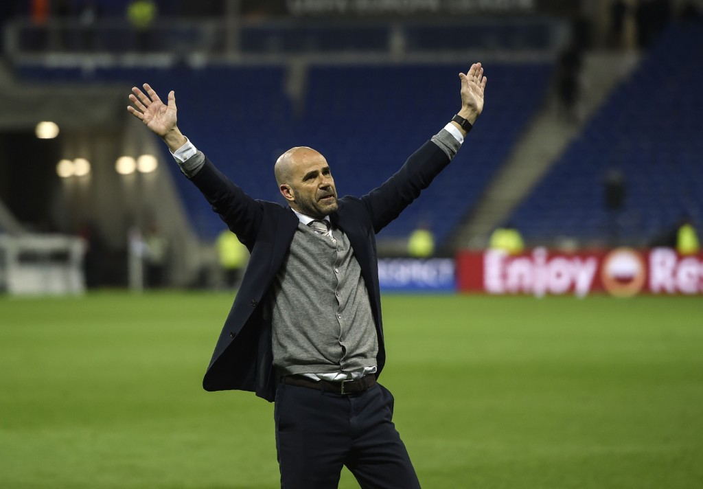 Ajax' Dutch head coach Peter Bosz celebrates with supporters after winning the UEFA Europa League semi-final football match between Olympique Lyonnais (OL) against Ajax Amsterdam, on May 11, 2017 at the Parc Olympique Lyonnais stadium in Décines-Charpieu near Lyon, southeastern France. / AFP PHOTO / PHILIPPE DESMAZES (Photo credit should read PHILIPPE DESMAZES/AFP/Getty Images)