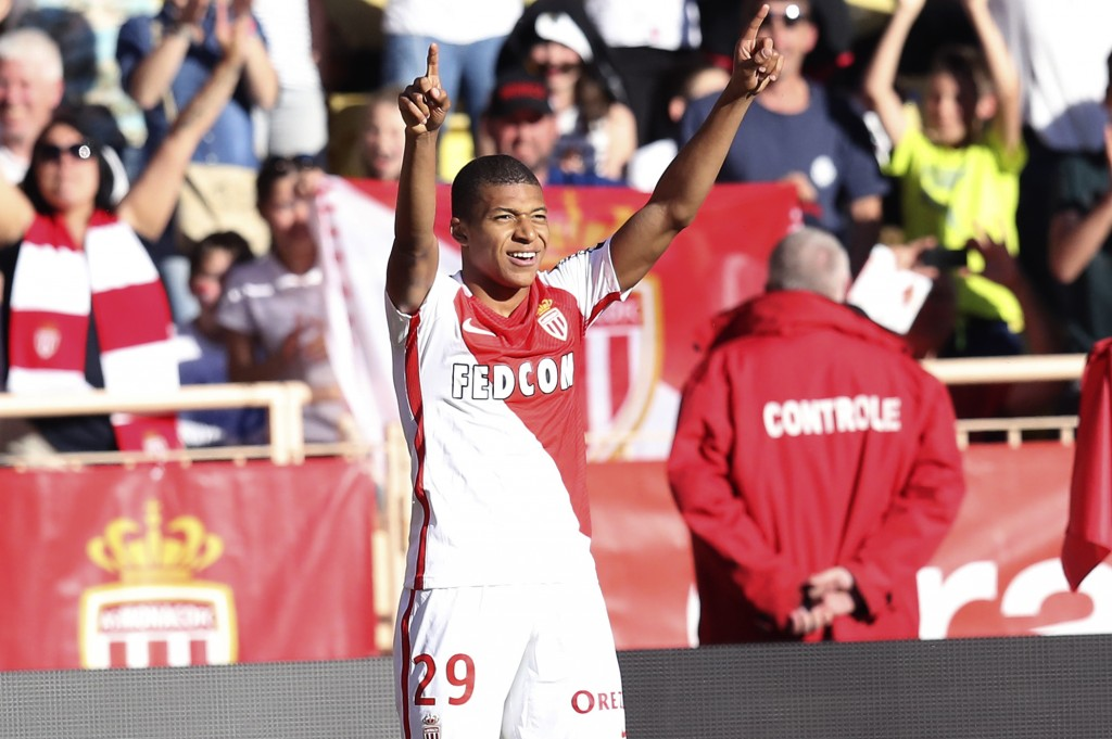 """Monaco's French forward Kylian Mbappe Lottin celebrates after scoring a goal during the French L1 football match Monaco (ASM) vs Toulouse (TFC) on April 29, 2017 at the """"Louis II Stadium"""" in Monaco. / AFP PHOTO / VALERY HACHE (Photo credit should read VALERY HACHE/AFP/Getty Images)"""