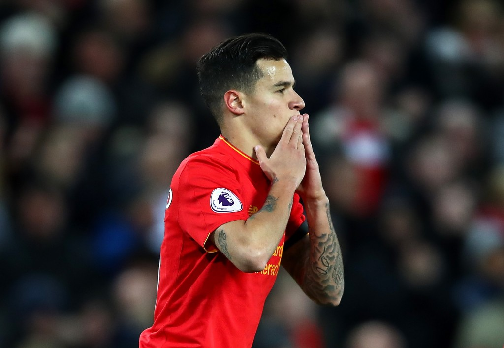 LIVERPOOL, ENGLAND - APRIL 05: Philippe Coutinho of Liverpool celebrates scoring his sides first goal during the Premier League match between Liverpool and AFC Bournemouth at Anfield on April 5, 2017 in Liverpool, England. (Photo by Clive Brunskill/Getty Images)