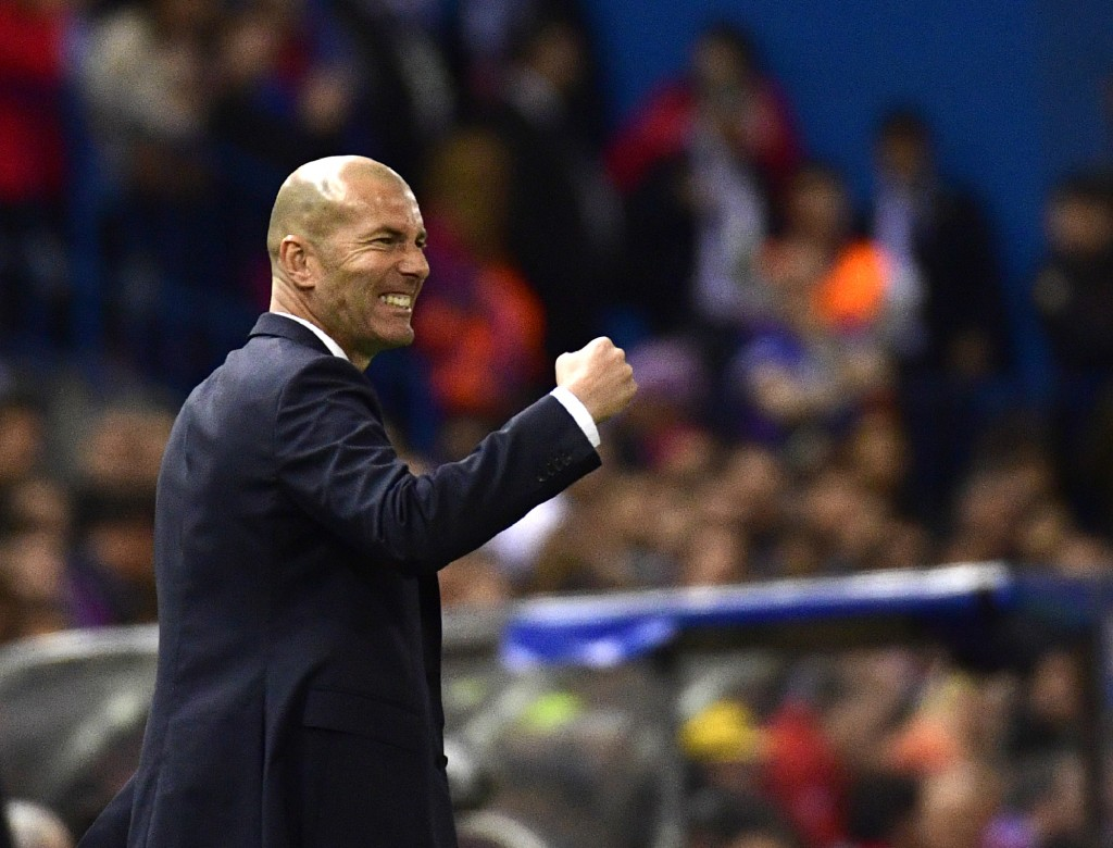 TOPSHOT - Real Madrid's French coach Zinedine Zidane gestures on the sideline during the UEFA Champions League semi final second leg football match Club Atletico de Madrid vs Real Madrid CF at the Vicente Calderon stadium in Madrid, on May 10, 2017. / AFP PHOTO / PIERRE-PHILIPPE MARCOU (Photo credit should read PIERRE-PHILIPPE MARCOU/AFP/Getty Images)