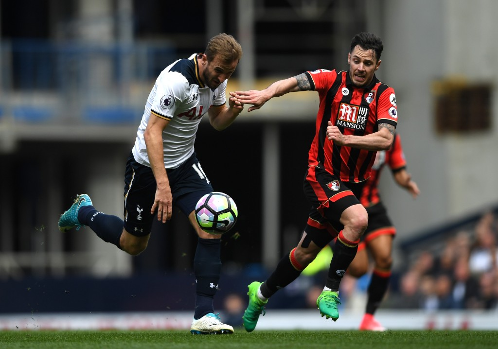 LONDON, ENGLAND - APRIL 15: Harry Kane of Tottenham Hotspur (L) and Adam Smith of AFC Bournemouth (R) battle for possession during the Premier League match between Tottenham Hotspur and AFC Bournemouth at White Hart Lane on April 15, 2017 in London, England. (Photo by Shaun Botterill/Getty Images)