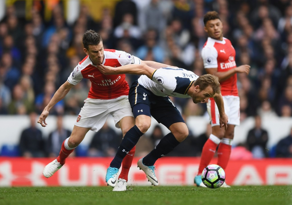 LONDON, ENGLAND - APRIL 30: Laurent Koscielny of Arsenal puts pressure on Harry Kane of Tottenham Hotspur during the Premier League match between Tottenham Hotspur and Arsenal at White Hart Lane on April 30, 2017 in London, England. (Photo by Shaun Botterill/Getty Images)