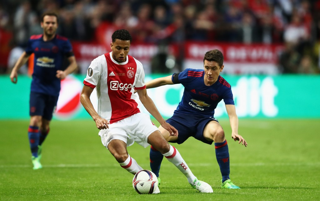 STOCKHOLM, SWEDEN - MAY 24: Jaïro Riedewald of Ajax and Ander Herrera of Manchester United in action during the UEFA Europa League Final between Ajax and Manchester United at Friends Arena on May 24, 2017 in Stockholm, Sweden. (Photo by Julian Finney/Getty Images)