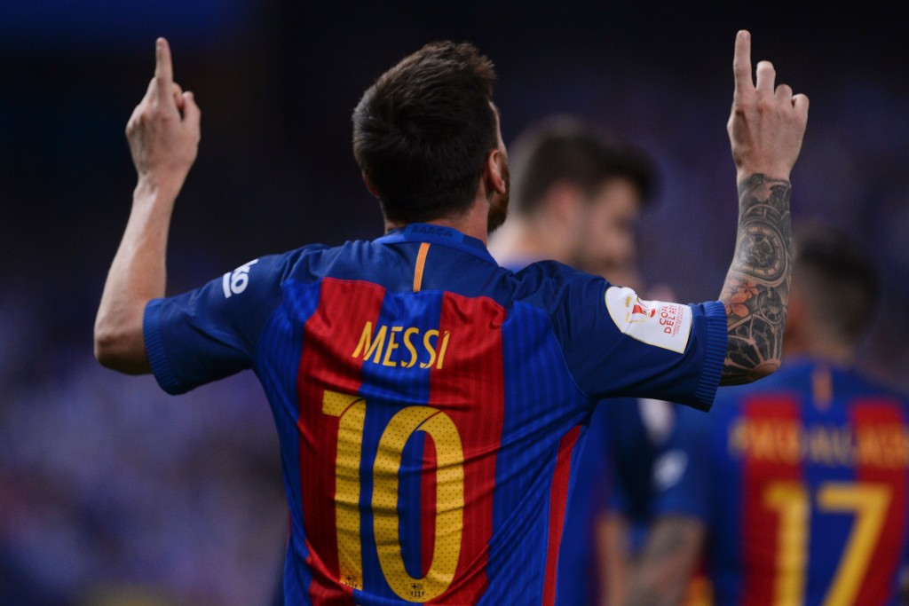 Barcelona's Argentinian forward Lionel Messi celebrates after scoring during the Spanish Copa del Rey (King's Cup) final football match FC Barcelona vs Deportivo Alaves at the Vicente Calderon stadium in Madrid on May 27, 2017. / AFP PHOTO / Josep LAGO (Photo credit should read JOSEP LAGO/AFP/Getty Images)