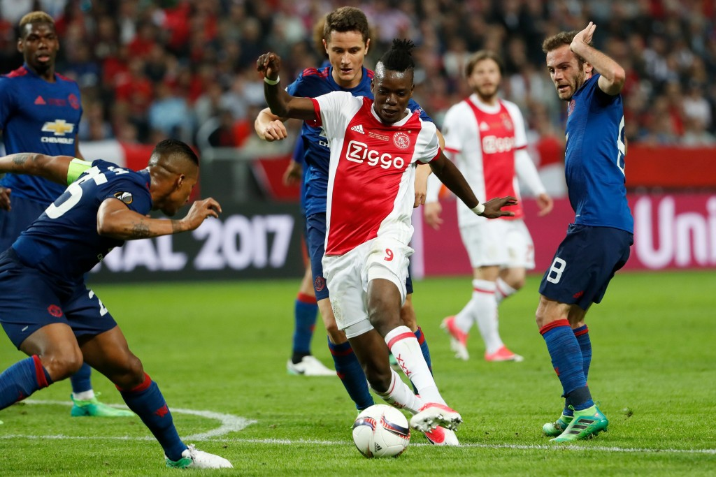 Ajax Burkinabe forward Bertrand Traoré (C) gets past Manchester United's Spanish midfielder Juan Mata (R) and Manchester United's Spanish midfielder Ander Herrera during the UEFA Europa League final football match Ajax Amsterdam v Manchester United on May 24, 2017 at the Friends Arena in Solna outside Stockholm. / AFP PHOTO / Odd ANDERSEN (Photo credit should read ODD ANDERSEN/AFP/Getty Images)