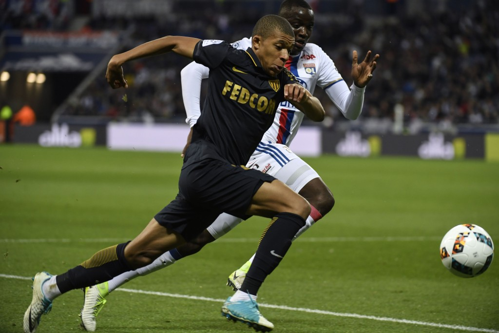 Monaco's French forward Kylian Mbappe Lottin (L) vies with Lyon's defender Mouctar Diakhaby (R) during the French L1 football match between Olympique Lyonnais and AS Monaco, on April 23, 2017 at Parc Olympique Lyonnais stadium in Decines-Charpieu near Lyon, southeastern France. / AFP PHOTO / PHILIPPE DESMAZES (Photo credit should read PHILIPPE DESMAZES/AFP/Getty Images)