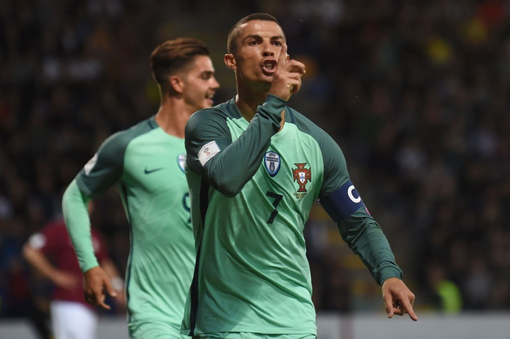Portugal's forward Cristiano Ronaldo (R) gestures during the FIFA World Cup 2018 qualification football match between Latvia and Portugal in Riga, on June 9, 2017. / AFP PHOTO / Janek SKARZYNSKI (Photo credit should read JANEK SKARZYNSKI/AFP/Getty Images)