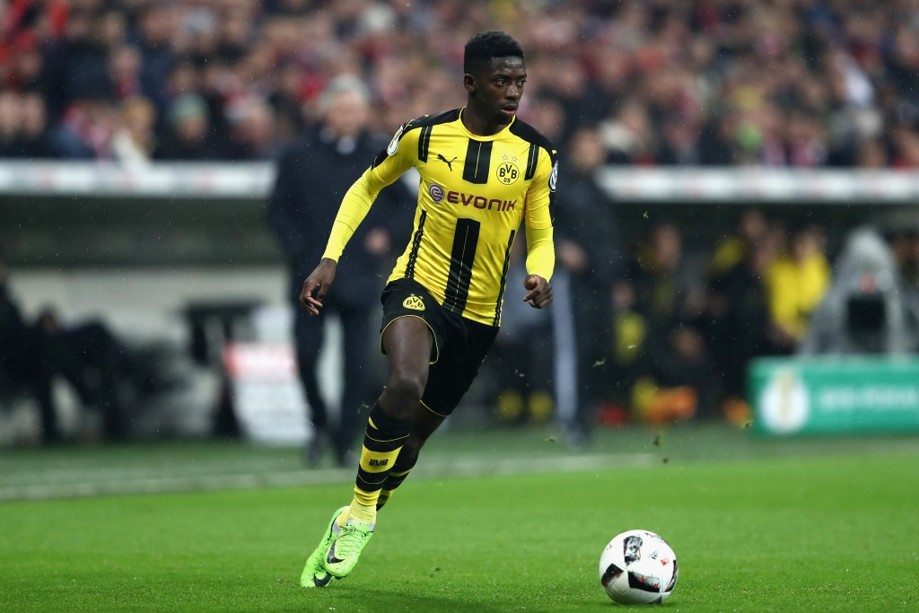 MUNICH, GERMANY - APRIL 26: Ousmane Dembele of Dortmund runs with the ball during the DFB Cup semi final match between FC Bayern Muenchen and Borussia Dortmund at Allianz Arena on April 26, 2017 in Munich, Germany. (Photo by Alexander Hassenstein/Bongarts/Getty Images)